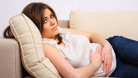С чем может быть связана боль в животе при беременности